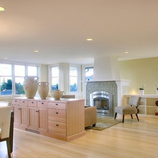 Elegant living room photo in Seattle with a tile fireplace