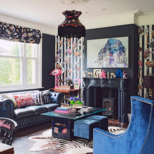 Inspiration for a bohemian living room in Berkshire with black walls, dark hardwood flooring and a wood burning stove.