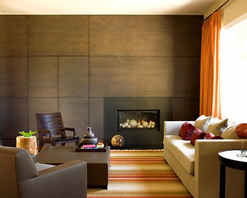 Contemporary living room idea in Los Angeles with brown walls and a  standard fireplace