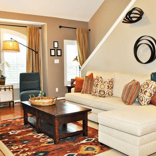 Example of a classic living room design in Houston with beige walls