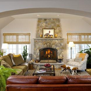 Ejemplo de salón contemporáneo con marco de chimenea de piedra
