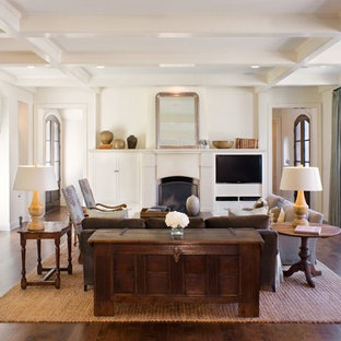 Inspiration for a transitional dark wood floor and brown floor living room remodel in Austin with white walls, a standard fireplace and a media wall