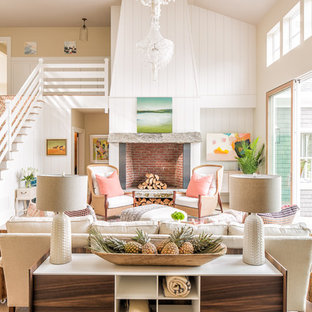 Coastal open concept living room photo in Portland Maine with white walls
