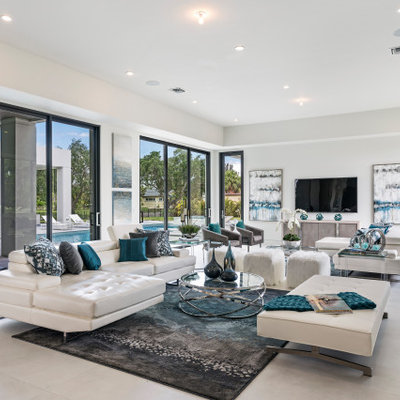 Inspiration for a contemporary open concept white floor living room remodel in Miami with white walls, no fireplace and a wall-mounted tv