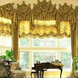 Custom and Luxury Drapery for Bay Window - Large bay window with a beautiful interior. Multi- dimension window treatments complemented the grandeur of the room.