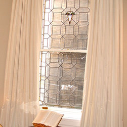 Custom draperies and window treatments - Linen curtain on a pole.  wooden pole natural finish with brass brackets, rings and finals