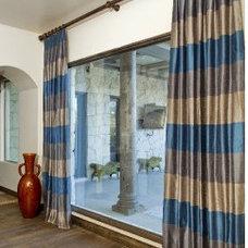 Living Room by Design Studio2010, LLC