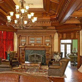 ニューヨークの巨大なトラディショナルスタイルのおしゃれな独立型リビング (フォーマル、黄色い壁、ラミネートの床、標準型暖炉、木材の暖炉まわり、黄色い床) の写真