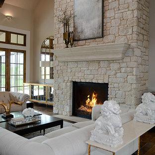Foto di un grande soggiorno design stile loft con sala formale, pareti beige, pavimento in legno massello medio, camino classico, cornice del camino in pietra e nessuna TV