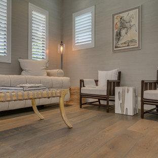 Foto de salón cerrado, actual, grande, sin chimenea y televisor, con paredes grises y suelo de madera pintada