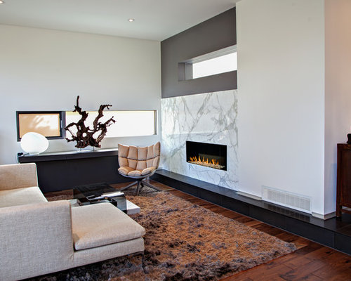 Large Trendy Formal Living Room Photo In Calgary With White Walls Medium Tone Hardwood Floors
