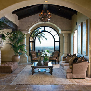 Example of a large classic formal and enclosed ceramic tile living room design in San Diego with beige walls, a standard fireplace and a stone fireplace