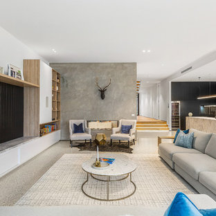 Large contemporary open concept living room in Melbourne with white walls, a built-in media wall, beige floor, concrete floors, a two-sided fireplace and a concrete fireplace surround.