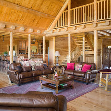 Rustic Living Room by Katahdin Cedar Log Homes