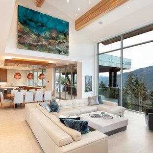Esempio di un ampio soggiorno contemporaneo aperto con pavimento con piastrelle in ceramica, pavimento beige e pareti bianche