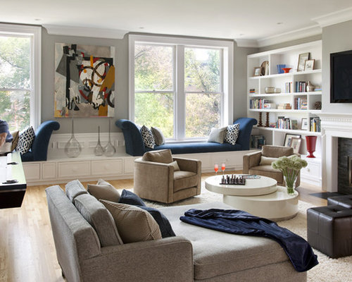 Contemporary living room idea in Boston with a stone fireplace surround