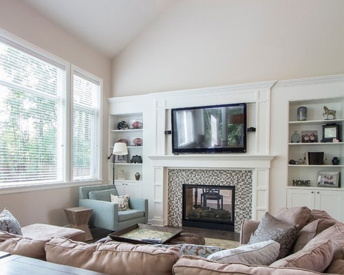 Inspiration For A Transitional Living Room Remodel In Seattle With Two Sided Fireplace And