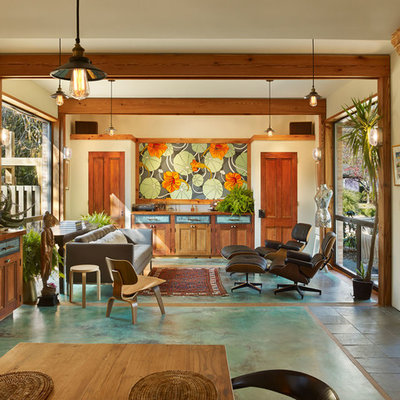 Living room - tropical open concept living room idea in New York with beige walls and no fireplace