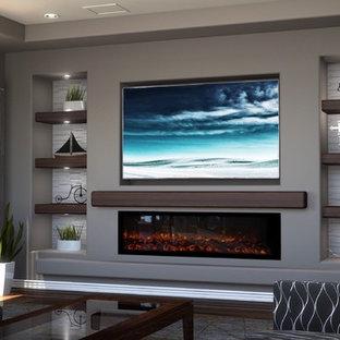 Bild på ett mellanstort vintage allrum med öppen planlösning, med grå väggar, mellanmörkt trägolv, en bred öppen spis, en spiselkrans i gips, en inbyggd mediavägg och brunt golv