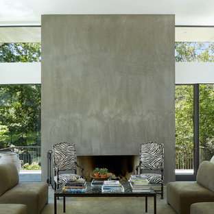 Inspiration for a mid-sized contemporary formal and open concept concrete floor living room remodel in Dallas with white walls, a standard fireplace and a concrete fireplace