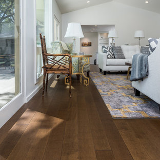 Example of a mid-sized transitional open concept dark wood floor and brown floor living room design in Dallas with white walls