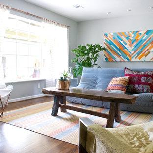 Eclectic dark wood floor living room photo in Dallas with gray walls