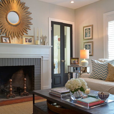 Living room - traditional living room idea in Dallas with gray walls, a standard fireplace and a brick fireplace