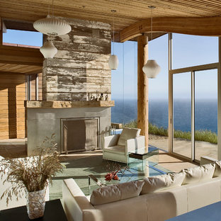 Large trendy limestone floor living room photo in San Francisco with a standard fireplace