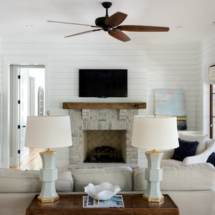 Living room - mid-sized country formal and enclosed light wood floor and beige floor living room idea in Charleston with white walls, a standard fireplace, a brick fireplace and a tv stand