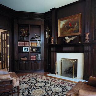 Immagine di un ampio soggiorno tradizionale con pavimento in legno massello medio