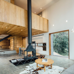 Example of a large trendy concrete floor living room design in Melbourne