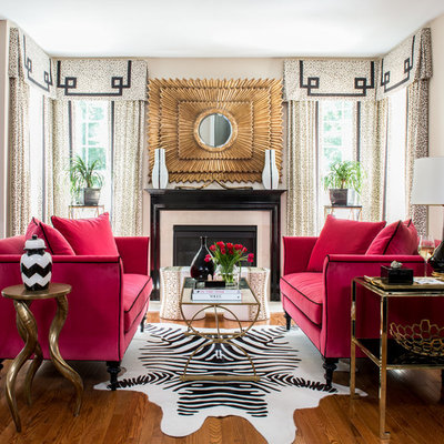 Example of a transitional formal medium tone wood floor living room design in DC Metro with a standard fireplace and no tv