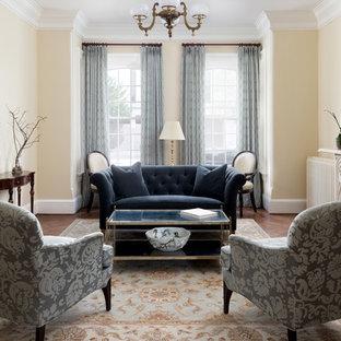ワシントンD.C.のヴィクトリアン調のおしゃれな独立型リビング (フォーマル、ベージュの壁、濃色無垢フローリング、標準型暖炉、コンクリートの暖炉まわり、テレビなし、茶色い床) の写真