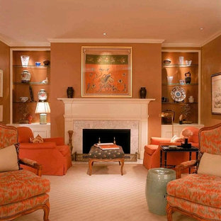 Photo of a medium sized classic formal enclosed living room in DC Metro with brown walls, carpet, a standard fireplace, a tiled fireplace surround, no tv and brown floors.