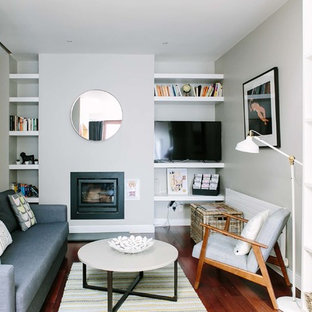Living room - small scandinavian enclosed dark wood floor living room idea in Dublin with white walls, a wood stove, a metal fireplace and a tv stand
