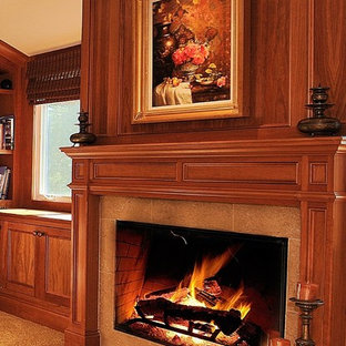 Example of a mid-sized classic formal and enclosed medium tone wood floor and beige floor living room design in Seattle with a standard fireplace, a tile fireplace, beige walls and no tv