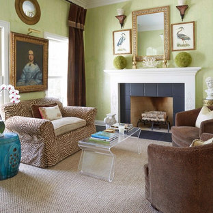 Elegant living room photo in Chicago with green walls and a standard fireplace