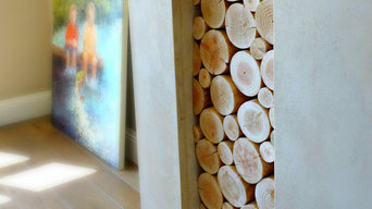 Decorative Logs Stacked in an Alcove of a Large Open Fireplace - Wooden Mantel