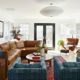 На фото: гостиная комната в стиле современная классика с белыми стенами, фасадом камина из кирпича, светлым паркетным полом, стандартным камином, телевизором на стене и бежевым полом с