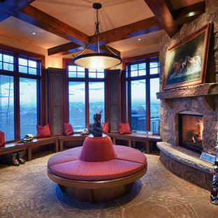 Inspiration for a large craftsman formal and enclosed slate floor living room remodel in Salt Lake City with beige walls, a standard fireplace, a stone fireplace and no tv
