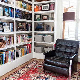 Living room library - mid-sized cottage open concept light wood floor living room library idea in DC Metro with beige walls and no fireplace