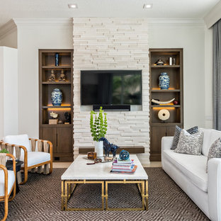 Inspiration for a large contemporary open concept limestone floor living room remodel in New York with white walls, a stone fireplace and a wall-mounted tv