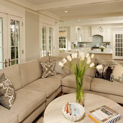 Elegant open concept living room photo in DC Metro with beige walls