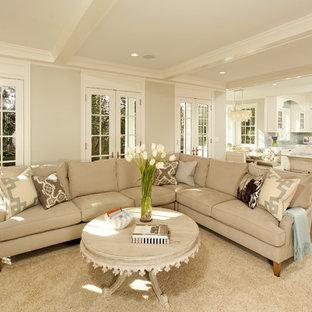Foto di un soggiorno chic aperto con pareti beige