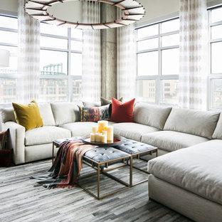 デンバーの中サイズのインダストリアルスタイルのおしゃれなリビング (白い壁、無垢フローリング、暖炉なし、壁掛け型テレビ、グレーの床) の写真