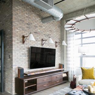 デンバーの中くらいのインダストリアルスタイルのおしゃれなリビング (白い壁、無垢フローリング、暖炉なし、壁掛け型テレビ、グレーの床) の写真
