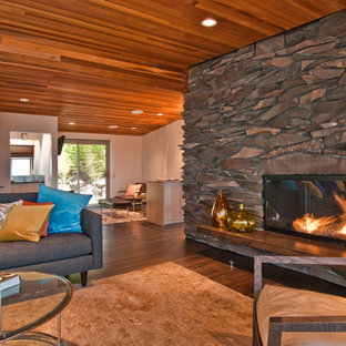 Inspiration for a midcentury living room in Seattle with a standard fireplace and a stone fireplace surround.