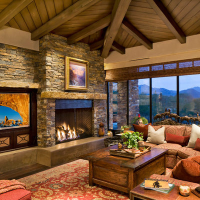 Living room - large contemporary open concept dark wood floor and brown floor living room idea in Phoenix with a stone fireplace, a standard fireplace, a media wall and beige walls