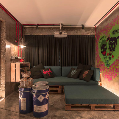 Urban concrete floor and gray floor living room photo in Singapore with gray walls