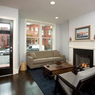 ワシントンD.C.の小さいトランジショナルスタイルのおしゃれなLDK (フォーマル、青い壁、濃色無垢フローリング、標準型暖炉、テレビなし、コンクリートの暖炉まわり) の写真